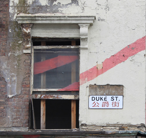Derelict building with Duke Street Sign