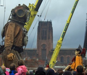 Sea Odyssey Uncle and little Girl Giant with Liverpool Cathedral in background